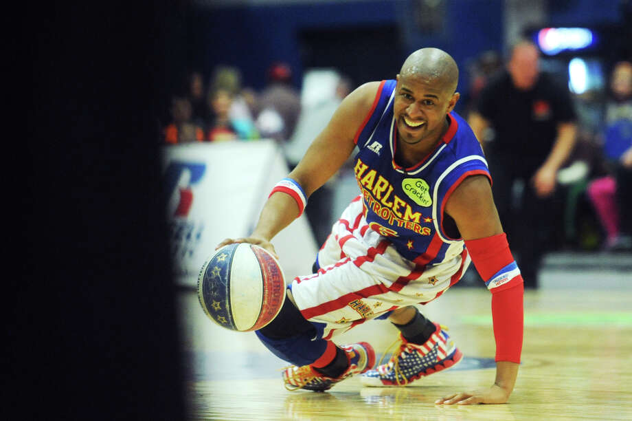 """""""Scooter"""" dribbles during the Harlem Globetrotters game at the O'Neill Center at Western Connecticut State University in Danbury, Conn. on Tuesday, March 26, 2013.  Hundreds of students and families crowded the arena to watch the basketball comedy act perform its interactive routine. Photo: Tyler Sizemore / The News-Times"""