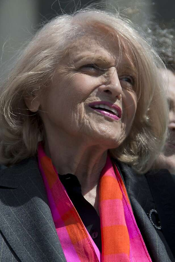 Plaintiff Edith Windsor of New York, speaks to reporters in Washington, Wednesday, March 27, 2013, after the Supreme Court heard arguments on the Defense of Marriage Act (DOMA) case. The U.S. Supreme Court, in the second day of gay marriage cases, turned Wednesday to a constitutional challenge to the federal law that prevents legally married gay Americans from collecting federal benefits generally available to straight married couples. (AP Photo/Carolyn Kaster) Photo: Carolyn Kaster, Associated Press