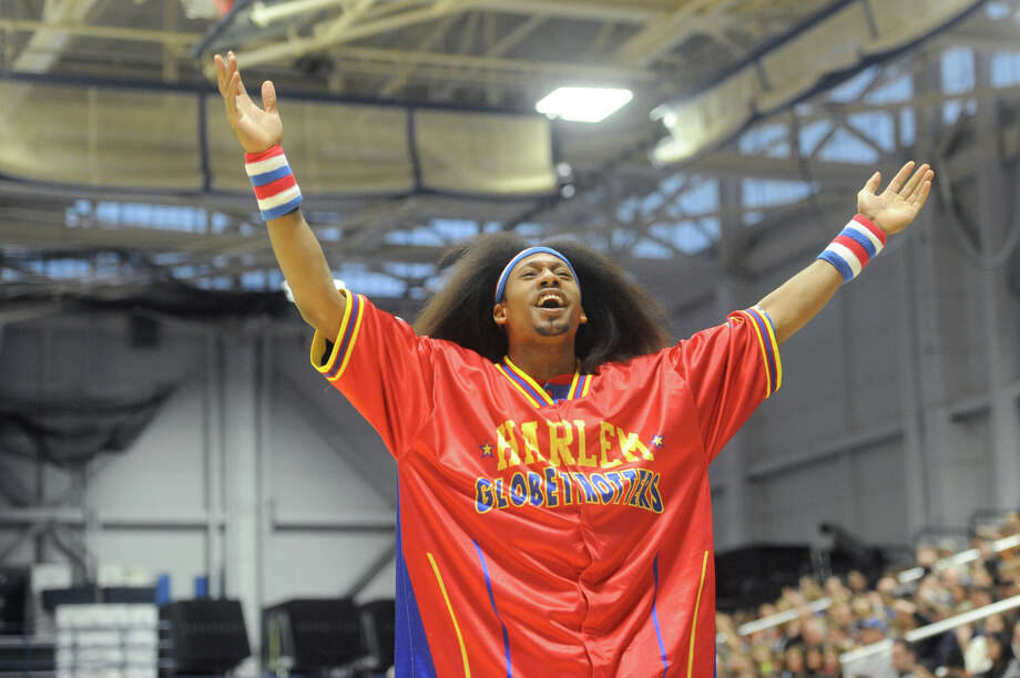"""Moose"" says hello to the crowd before the Harlem Globetrotters game at the O'Neill Center at Western Connecticut State University in Danbury, Conn. on Tuesday, March 26, 2013.  Hundreds of students and families crowded the arena to watch the basketball comedy act perform its interactive routine. Photo: Tyler Sizemore / The News-Times"