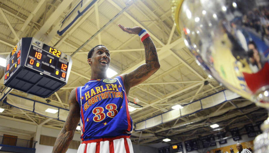 """Bull"" waves to the crowd during the Harlem Globetrotters game at the O'Neill Center at Western Connecticut State University in Danbury, Conn. on Tuesday, March 26, 2013.  Hundreds of students and families crowded the arena to watch the basketball comedy act perform its interactive routine. Photo: Tyler Sizemore / The News-Times"