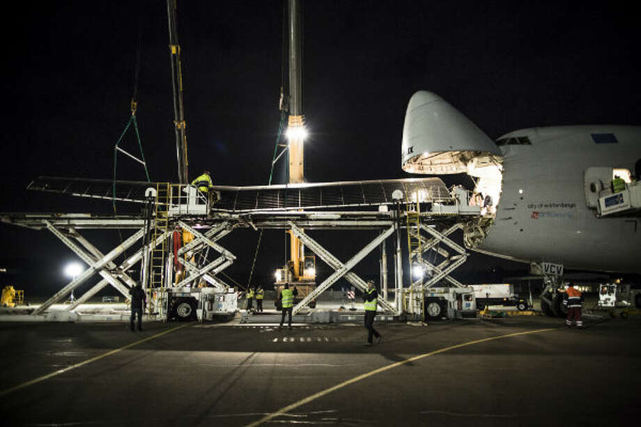 A wing of the Solar Impulse is loaded onto a Boeing 747 in Payerne, Switzerland in February 2013. The plane was heading to California to prepare for a cross-country flight this spring.