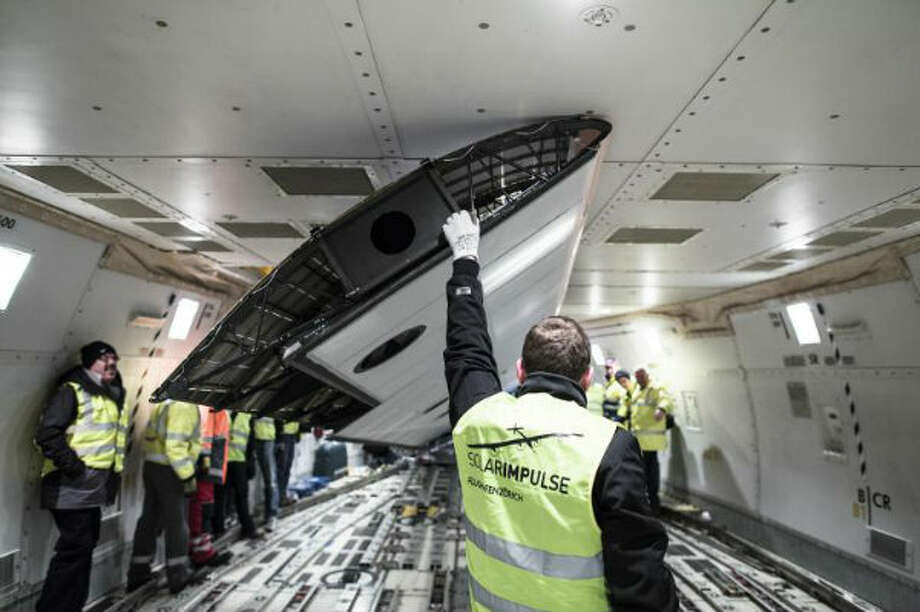 Engineers position a wing of the Solar Impulse inside the belly of Boeing 747 in Payerne, Switzerland in February 2013. The plane was flown to California, where it is now preparing to make a cross-country flight.