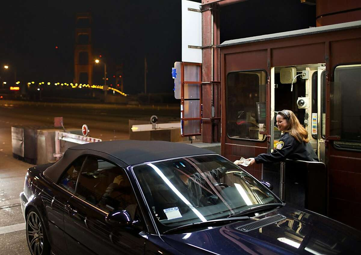 Toll collector for 29 years, Marilyn Alvarado accepts payment from one of the last cars able to pay cash during the last shift at the Golden Gate Bridge on Tuesday, March 26, 2013 in San Francisco, Calif. Alvarado accepted the final cash toll on the bridge shortly after midnight.