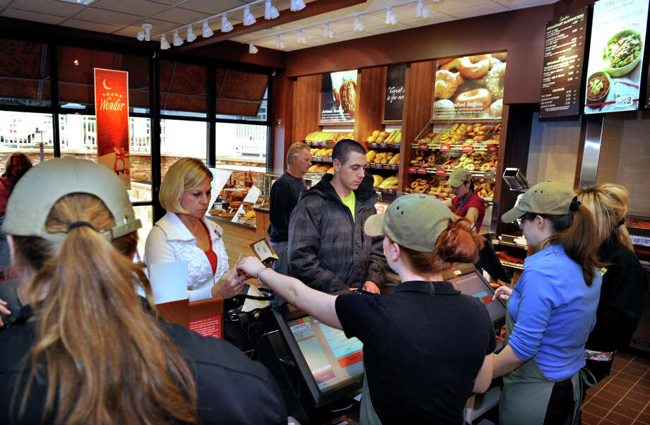 This file photo shows activity inside a Panera Bread bakery-café in Southbury on Dec. 6, 2011, shortly after that branch opened. Three years after launching the first of five pay-what-you-want cafes, the suburban St. Louis-based chain on Wednesday launched a trial run of the concept to all 48 cafes in the St. Louis region. If the experiment works, it could be expanded to the chain's 1,600 bakery-cafes across the country.  Staff Photographer Carol Kaliff Photo: File Photo / Stamford Advocate File Photo