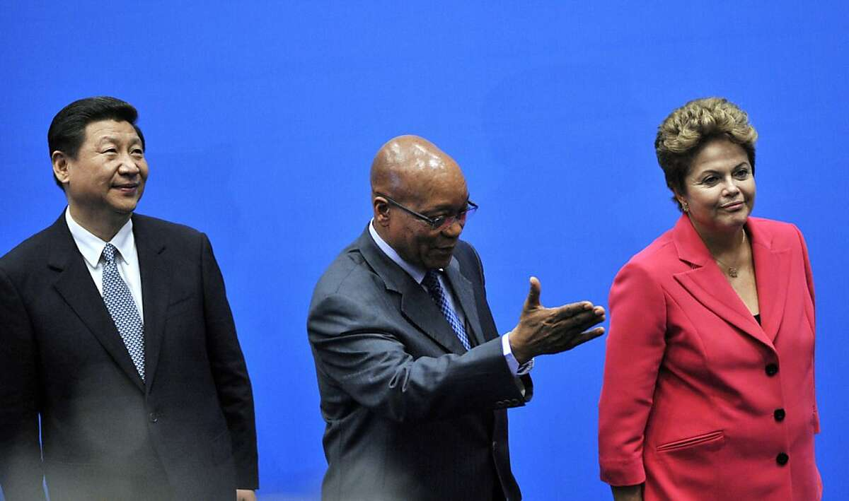 BRICS leaders (From L) President of the People's Republic of China Xi Jinping, South Africa's President Jacob Zuma, and Brazil's President Dilma Rousseff arrives for a family photo in Durban on March 27, 2013. Leaders from the BRICS group of emerging powers failed to launch a much-anticipated new development bank to rival Western-dominated institutions like the World Bank. AFP PHOTO / ALEXANDER JOEALEXANDER JOE/AFP/Getty Images