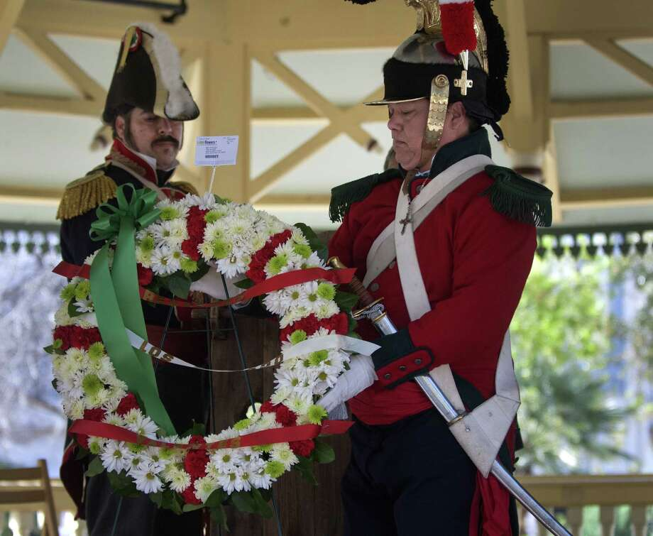 Mexican soldiers place a wreath during a ceremony honoring Mexican soldiers who fell at the Battle of the Alamo. A reader comments on the controversy over the tribute. Photo: Steven Faulisi, San Antonio Express-News