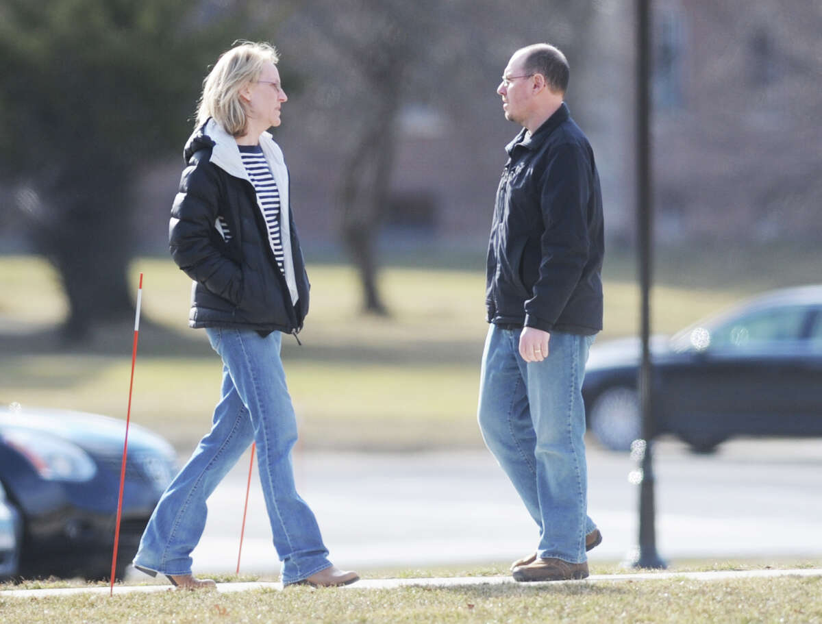 Two people arrive at the Newtown Municipal Center for the state police debriefing for families involved in the Sandy Hook shooting in Newtown, Conn. on Wednesday, March 27, 2013.