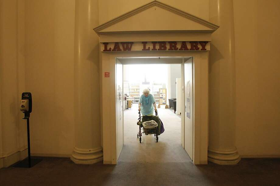 Nancy Cross, a frequent user of the law library, is seen during a visit in November. Patrons want the city to provide more space in a new home. Photo: Alejandra Bayardo, The Chronicle