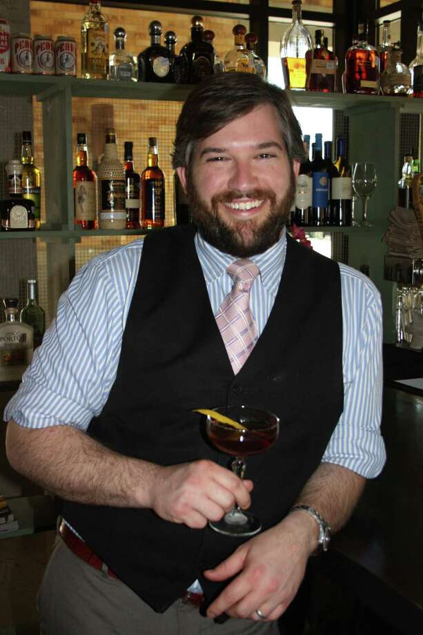 Chris Ware is the bar manager at Arcade Midtown Kitchen. Photo: Jennifer McInnis /