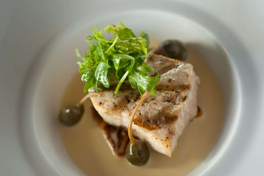 Grilled swordfish is sometimes available at Laurent's Modern Cuisine, 4230 McCullough Ave. Photo: Express-News File Photo