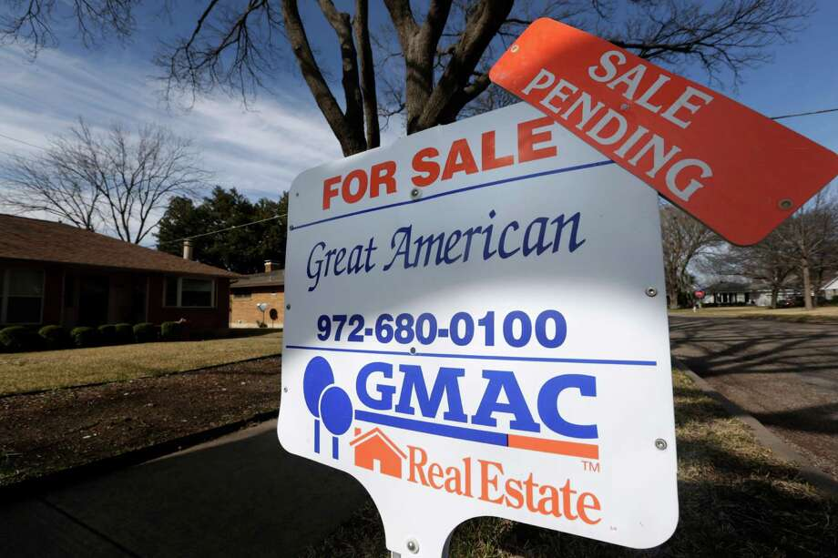 In this Friday, Feb. 22, 2013, photo, a sale pending announcement sits atop a for sale sign in a home's yard in Richardson, Texas.  Fewer Americans signed contracts to buy homes in February, but the level stayed close to a nearly three-year high. The report suggests sales of previously occupied homes will keep rising in the coming months.  (AP Photo/LM Otero) Photo: LM Otero