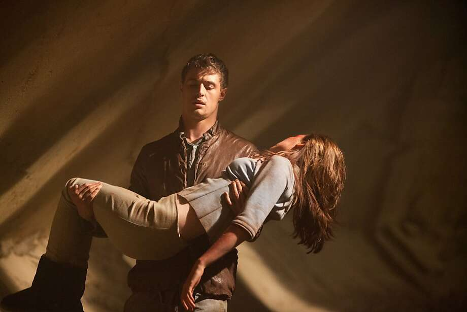 """Max Irons and Saoirse Ronan star in """"The Host,"""" a science fiction romance based on a book by """"Twilight"""" author Stephenie Meyer. Opens Friday. Click here movie listings.  Photo: Alan Markfield, Open Road Films"""