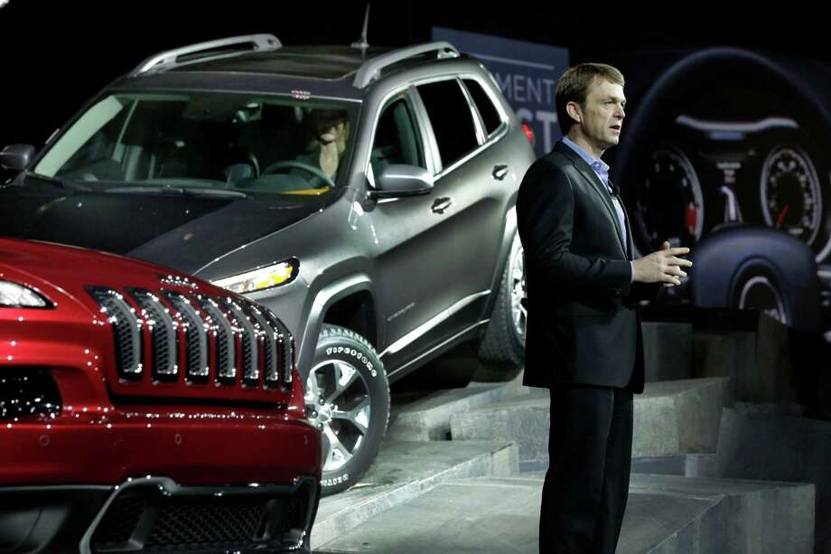 Jeep CEO Mike Manley presents the 2014 Jeep Cherokee Limited, left, and Cherokee Trailhawk at the New York International Auto Show, at New York's Javits Center,  Wednesday, March 27, 2013. (AP Photo/Richard Drew) Photo: Richard Drew