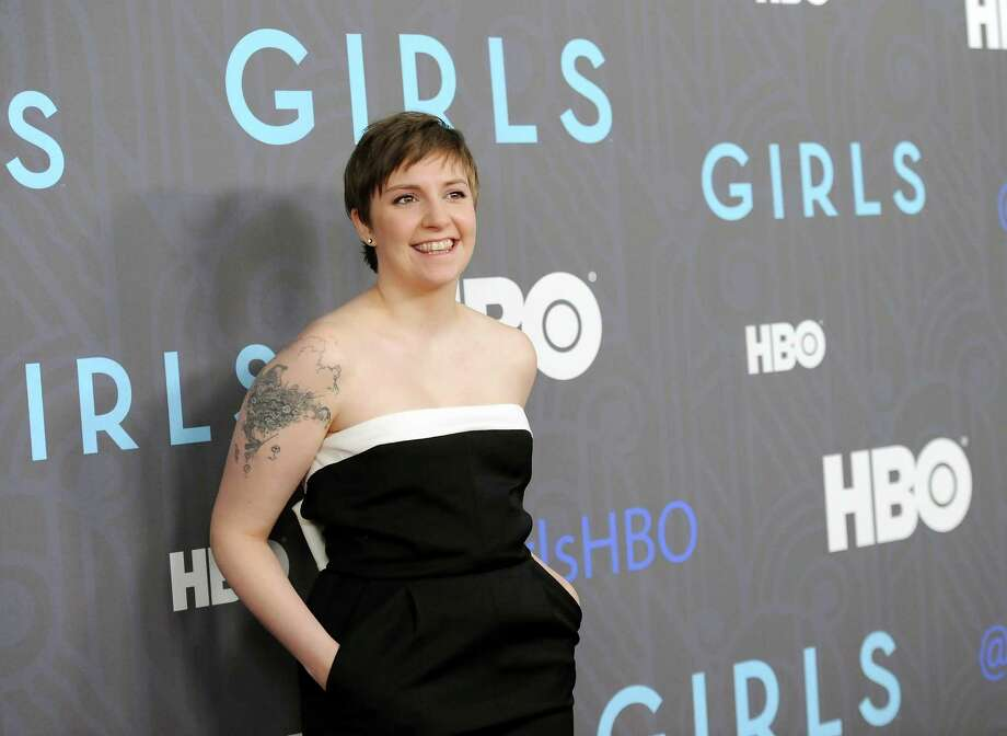 """FILE - This Jan. 9, 2013 file photo shows creator, executive producer and actress Lena Dunham at the HBO premiere of """"Girls"""" at the NYU Skirball Center in New York. The series is one of the recipients of the 72nd annual Peabody Awards, announced Wednesday, March 27, 2013,  by the University of Georgia's journalism school. They were chosen by the Peabody board as the best electronic media works of 2012. (Photo by Evan Agostini/Invision/AP, file) Photo: Evan Agostini, INVL / Invision"""
