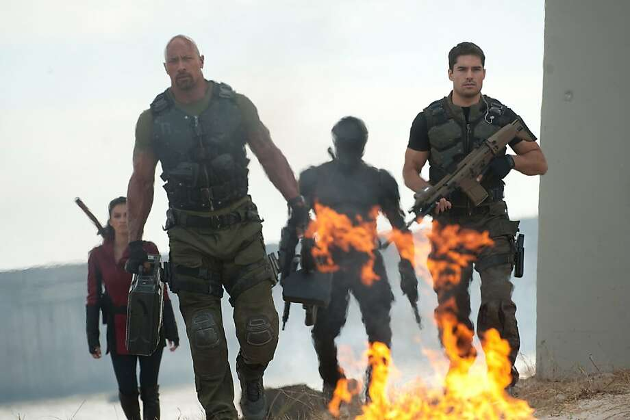 Left to right: Elodie Yung plays Jinx, Dwayne Johnson plays Roadblock, Ray Park plays Snake Eyes, and D.J. Cotrona plays Flint in G.I. JOE: RETALIATION, from Paramount Pictures, MGM, and Skydance Productions.GR-17007 Photo:  Jaimie Trueblood, Paramount Pictures