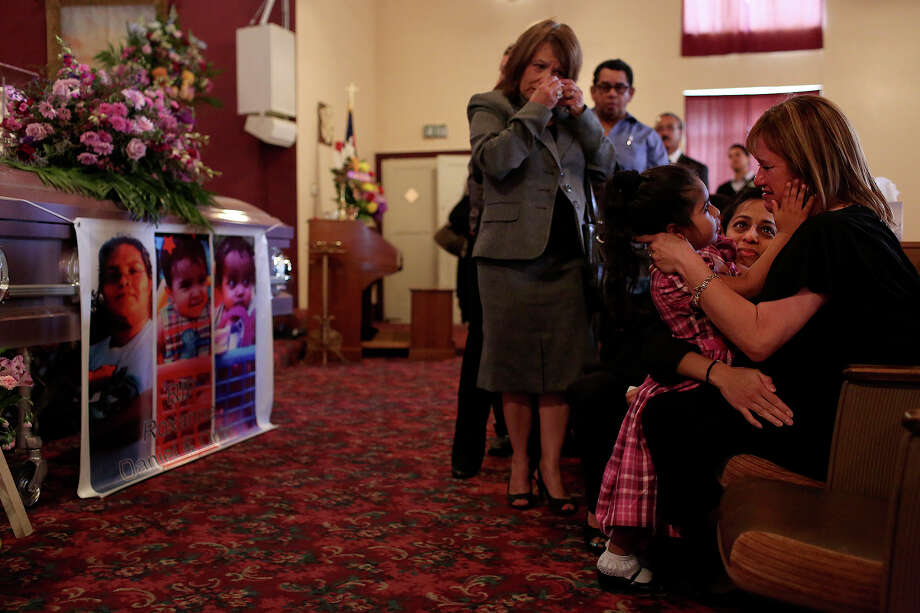 Selena Ordonez, 3, the daughter of Roxanne Moreno-Ordonez, comforts her grandmother and Roxanne's mother, Vangie Chaires, far right, with Roxanne's cousin and Selena's Godmother, Melissa Henderson, during the funeral for Roxanne and her one-year-old twin boys who were killed in a house fire sparked by wildfire last month, at Beacon Hill Baptist Church in San Antonio on Wednesday, March 27, 2013. Photo: Lisa Krantz, San Antonio Express-News / San Antonio Express-News