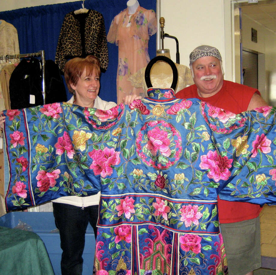 You never know what you'll find at The Danbury Vintage Show, Saturday and Sunday, April 6 and 7, at the Police Athletic League Building in Danbury. Here Debra and Mickey Pezzullo show off a vintage kimono. Photo: Contributed Photo