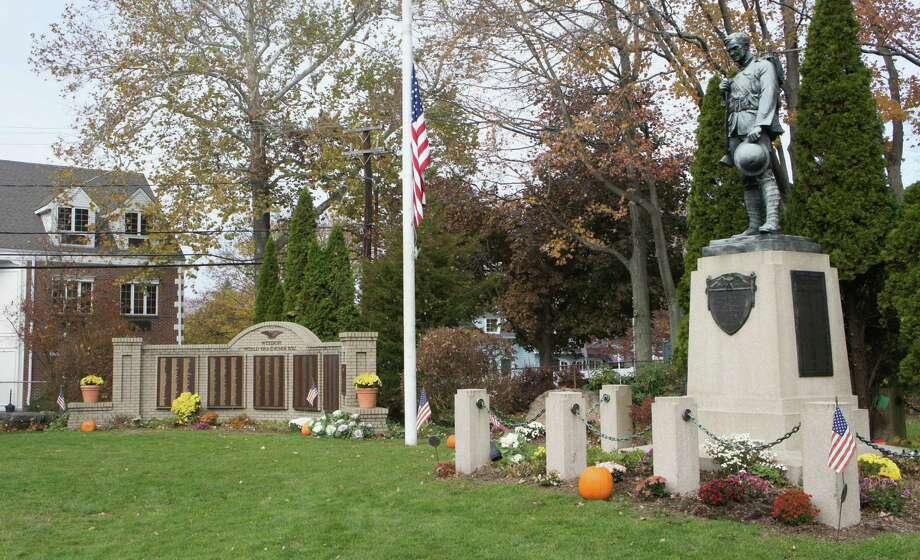 Westport's war memorials at Veterans Green honor those who made the ultimate sacrifice. Photo: Paul Schott / Westport News