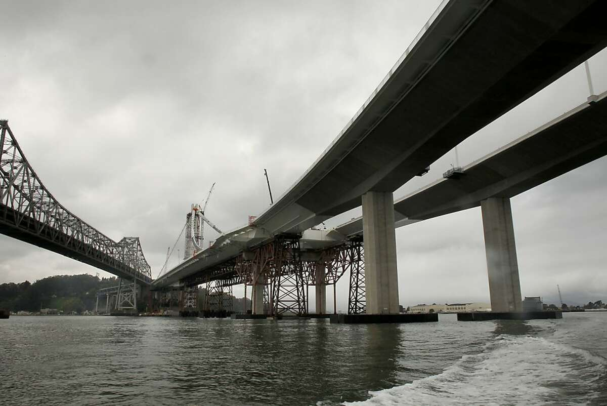 The eastern side of the old, (left)and new eastern section of the Bay Bridge as construction continues while CalTrans conducts a boat tour of the impacted areas of the bridge on Wednesday Mar. 27, 2013, in Oakland, Ca. Inspections earlier this month found that 30 large bolts on the new eastern span of the Bay Bridge have fractured.