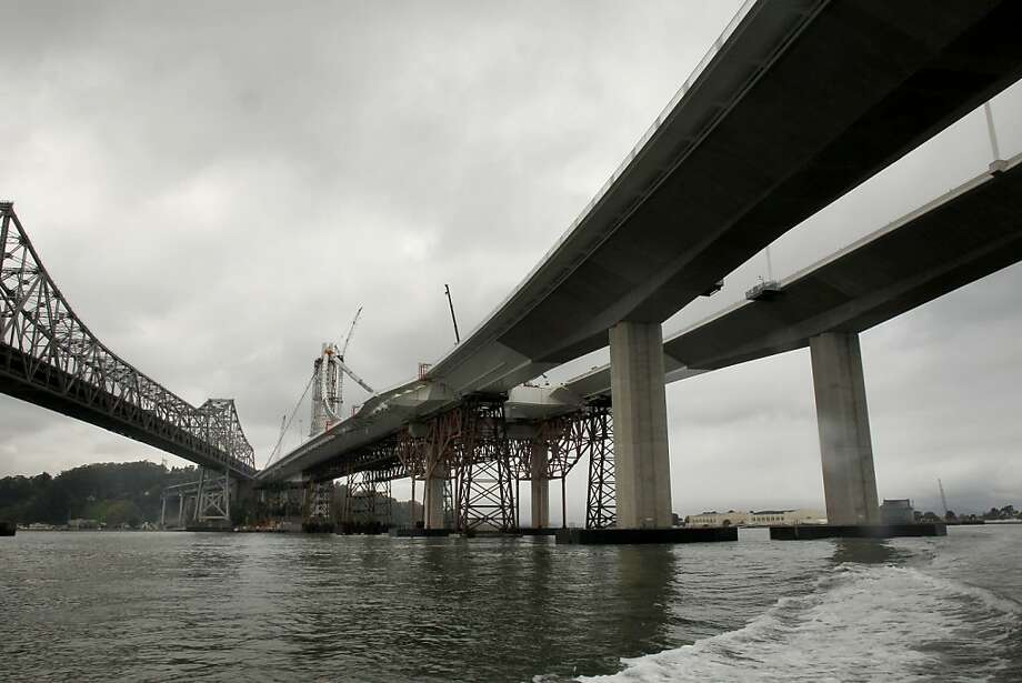 The new eastern span (right) of the Bay Bridge is supposed to open with fanfare over Labor Day weekend. Photo: Michael Macor, The Chronicle