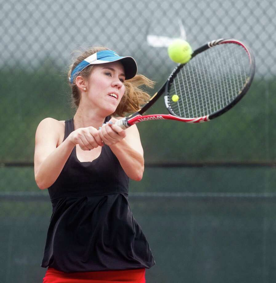 New Canaan's Jensen Lee in action during the FCIAC girls tennis championships at Wilton High School in Wilton, Conn., May 24, 2012. Photo: Keelin Daly / Stamford Advocate