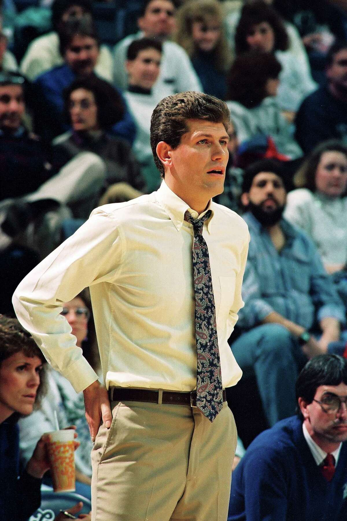 Italian-born American basketball coach Geno Auriemma of the University of Connecticut watches the action during a game in Gampel Pavilion, Storrs, Connecticut, 1991. (Photo by Bob Stowell/Getty Images)