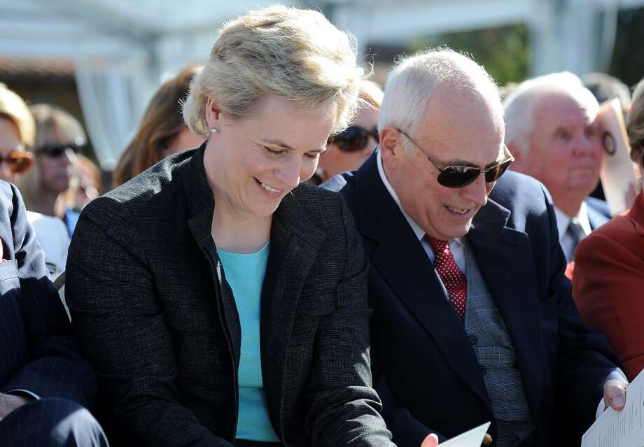 Ex-Vice President Dick Cheney and his daughter Mary Cheney.  She is in same-sex marriage and raising two children.  Cheney, an outspoken conservative, supports marriage equality.