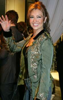 "Thalia waves as she arrives to the store opening party for Sean ""P. Diddy"" Combs' first ""Sean John"" store on New York's Fifth Avenue Thursday Sept. 9, 2004.(AP Photo/Tina Fineberg)  HOUCHRON CAPTION  (02/02/2005) SECNEWS:  THALIA. Photo: TINA FINEBERG, STR / AP"