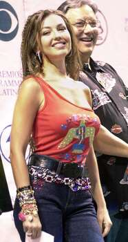 Singer Thalia smiles during the nomination ceremony for the Latin Grammy Awards at the American Airlines Arena in Miami Tuesday, July 17, 2001. Thalia was nominated for a best female pop vocal album. Behind her is trumpeteer Arturo Sandoval. The Latin Grammy Awards will take place in Miami September 11, 2001. (AP Photo/Marta Lavandier) Photo: MARTA LAVANDIER, STF / AP