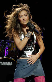 Latin singer Thalia performs prior to the season opener between the San Antonio Spurs and the Phoenix Suns in San Antonio, Tuesday, Oct. 28, 2003. (AP Photo/Eric Gay)  HOUCHRON CAPTION (11/05/2003):  The boundary-pushing hip-hop of the Black Eyed Peas, Houston-born Billboard chart-topper Hilary Duff, (NOT SHOWN), Jamaican dance-hall star Sean Paul, Latin crossover diva Thalia, (PICTURED), and Canadian punk newcomers Simple Plan make up the diverse lineup for the fifth annual Jingle Jam. ....ON two / LINING UP FOR THE JINGLE JAM. Photo: ERIC GAY, STF / AP