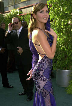 ** FILE ** Mexican singer and nominee Thalia, right, poses for photographers as husband Tommy Mottola looks on as they arrive at the 3rd annual Latin Grammy Awards in the Hollywood district of Los Angeles, in this Sept. 18, 2002, file photo. The sisters of Mexican singer-actress Thalia were followed and ambushed after leaving a play, unidentified witnesses told local media in reports published Tuesday, Sept. 24, 2002.  (AP Photo/Kim D. Johnson, File)   HOUCHRON CAPTION (09/25/2002):  Thalia.  Business briefs / Nation & World. Photo: KIM D. JOHNSON, STF / AP