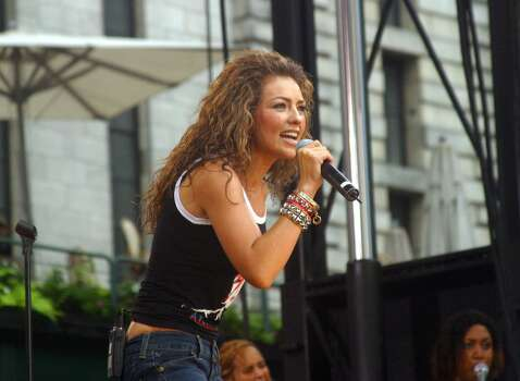 "KRT ENTERTAINMENT STAND ALONE PHOTO SLUGGED: THALIA KRT PHOTOGRAPH BY DARLA KHAZEI/ABACA PRESS (August 8) NEW YORK CITY, NY--  Thalia performs in Bryant Park for the Good Morning America concert series, Friday August 8, 2003 in New York. (lde)  2003.  HOUCHRON CAPTION (11/27/2003):  Mexican pop singer and fashionista Thalia leads the list of the most inspiring Latinas of 2003, according to the December-January issue of Latina magazine. The magazine says Thalia has enjoyed a double triumph this year: I Want You, her English-language duet with rapper Fat Joe, is a big hit, and she has launched a line of clothing at Kmart. ""I have a little angelic face,"" she says, ""but at the same time, I have a lion inside."" Photo: DARLA KHAZEI, MBR / ABACA PRESS"