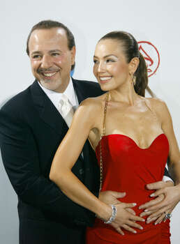 "Mexican singer Thalia and her husband Tommy Mottola arrive at the American Airlines Arena for the 4th Annual Latin Grammy Awards in Miami Wednesday Sept. 3, 2003. Thalia's album ""Thalia"" was nominated in the Best Female Pop Vocal Album category. (AP Photo/Wilfredo Lee) Photo: WILFREDO LEE, STF / AP"