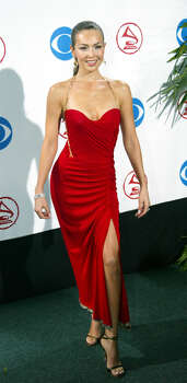 "Mexican singer Thalia arrives at the American Airlines Arena for the 4th Annual Latin Grammy Awards in Miami Wednesday Sept. 3, 2003. Thalia's album""Thalia"" is nominated in the Best Female Pop Vocal Album category. (AP Photo/Wilfredo Lee) Photo: WILFREDO LEE, STF / AP"