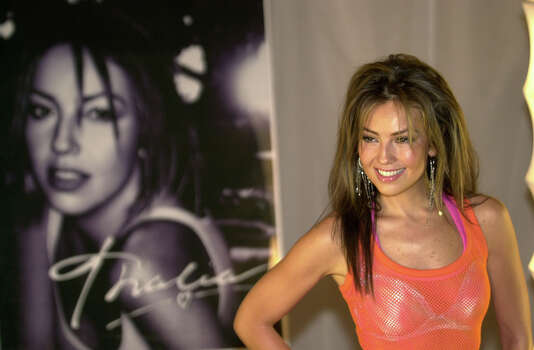 "Mexican singer Thalia poses for photographers during a press conference in Mexico City, June 2, 2003. Her 11th album, ""Thalia,"" her first record recorded in English, is due out July 8 by Virgin Records.(AP Photo/Jaime Puebla).  HOUCHRON CAPTION  (06/03/2003):  Singer Thalia poses during a news conference Monday in Mexico City. Her 11th album, ``Thalia,'' coming out July 8, will be her first in English. Photo: JAIME PUEBLA, STF / AP"