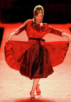 Celebrity model Thalia displays a look by Vera Wang from the 2006 Fall/Winter Heart Truth Red Dress Collection during Olympus Fashion Week in New York City, 02/03/06. (Buster Dean/Chronicle) Photo: Buster Dean, Staff / Houston Chronicle