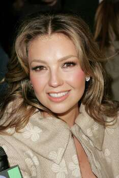 NEW YORK - SEPTEMBER 11:  Singer Thalia poses in the front row at the Luca Luca Spring 2007 fashion show during Olympus Fashion Week at the Promenade in Bryant Park September 11, 2006 in New York City.  (Photo by Bryan Bedder/Getty Images For IMG) *** Local Caption *** Thalia Photo: Bryan Bedder, Staff / Getty Images North America