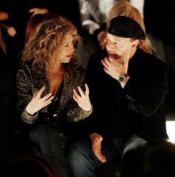 Thalia and Tommy Mottola watch the Vera Wang spring 2007 fashion show, Thursday, Sept. 14, 2006, in New York.  (AP Photo/Seth Wenig) Photo: SETH WENIG, STF / AP
