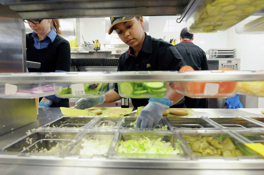 Kitchen manager, Jaclyn Detoro, left, and Kiara Pirela fill orders in the kitchen area at the newly opened McDonald's at the corner of Hoosick and 15th Streets, on Wednesday, March 27, 2013 in Troy, NY.   (Paul Buckowski / Times Union) Photo: Paul Buckowski