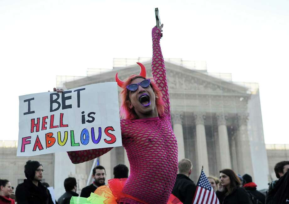 A gay supporter dances in front of the Supreme Court on March 26, 2013 in Washington, DC. Same-sex marriage takes center stage at the US Supreme Court on Tuesday as the justices begin hearing oral arguments on the emotionally-charged issue that has split the nation. Photo: JEWEL SAMAD, Getty Images / 2013 AFP