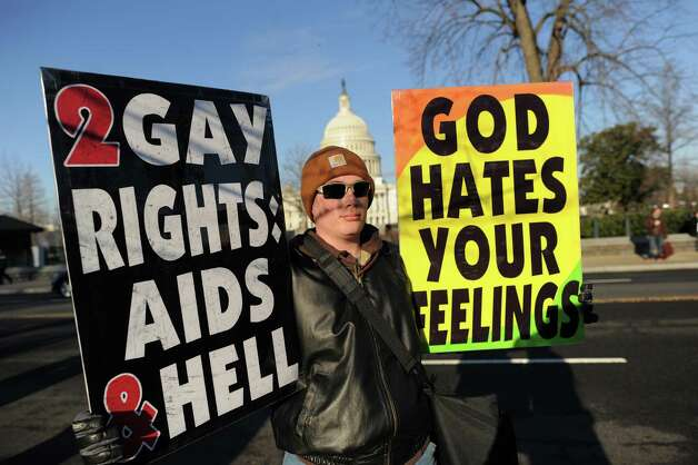 Anti-gay protesters display placards in front of the US Supreme Court on March 26, 2013 in Washington, DC. Photo: JEWEL SAMAD, Getty Images / 2013 AFP