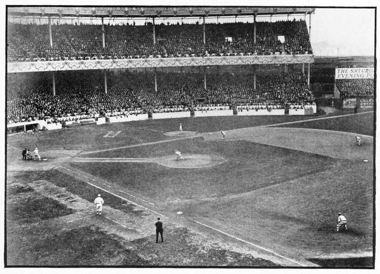 The first pitch is being delivered in the 1913 World Series in the Polo Grounds, with Rube Marquard