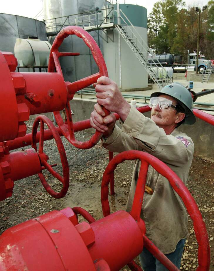 Steve Byrd adjusts a valve at a Heckmann Water Resources plant that separates oil, sediment and water — lots of water — mixed during the hydraulic fracturing process, near Carthage. Photo: Bloomberg File Photo