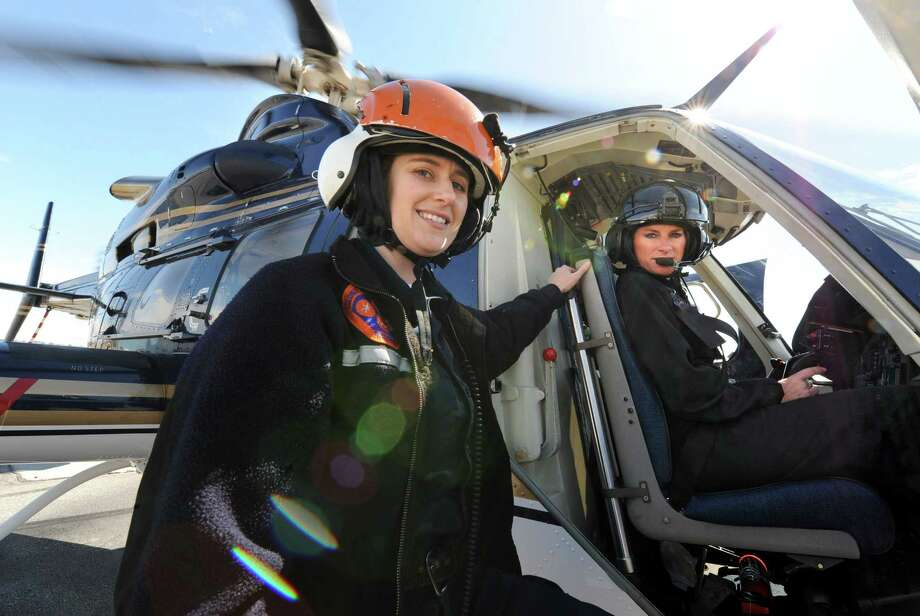 Colonie paramedic Mary Pat Provost and Kathy Humphries, Tech Sgt. with the NYS police, with a helicopter on Wednesday, March 27, 2013 in Colonie, N.Y.  Tech Sgt. Humphries recently made New York State Police history when she piloted an all female medevac flight mission. On that mission were two female paramedics from Colonie,  Mary Pat Provost, left, and Mary Beth Pulver, not pictured. Humphries is the first and only female NYS Police helicopter pilot. The former U.S. army pilot has been with the state police for 18 years.(Lori Van Buren / Times Union) Photo: Lori Van Buren