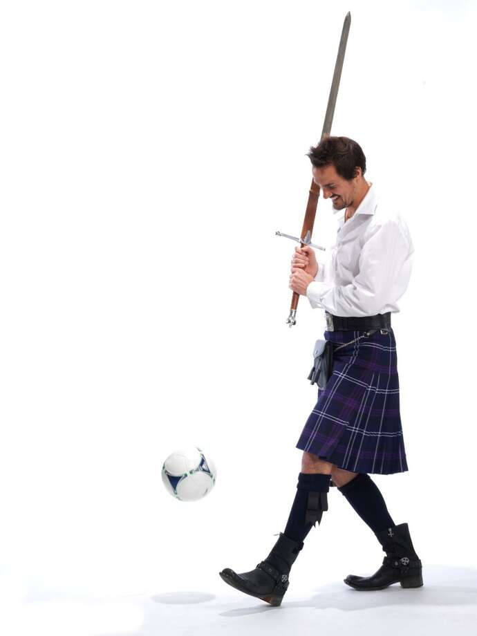 Former Sounders player Roger Levesque poses for a photo as part of the Ronald McDonald House ''Men in Kilts'' fundraising campaign.