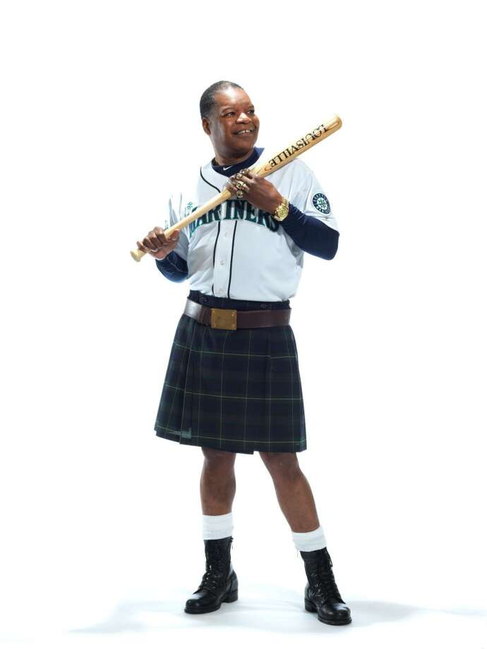 Former Mariners star Dave Henderson poses for a photo as part of the Ronald McDonald House ''Men in Kilts'' fundraising campaign.