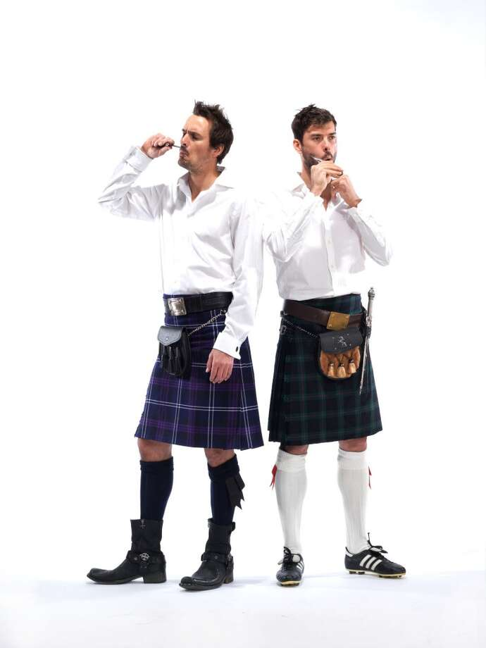 Former Sounders player Roger Levesque, left, and current Sounders midfielder Brad Evans pose for a photo as part of the Ronald McDonald House ''Men in Kilts'' fundraising campaign.