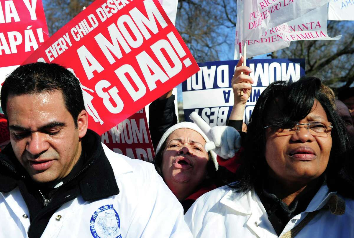 Members of the New York Hispanic Clergy Organization shout anti gay marriage slogans in front of the US Supreme Court March 26, 2013 in Washington, DC.