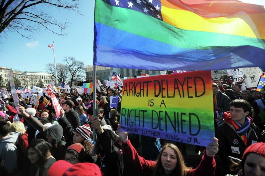 Same-sex marriage supporters shout slogans in front of the Supreme Court on March 26, 2013 in Washington, D.C. Photo: JEWEL SAMAD, Getty Images / 2013 AFP