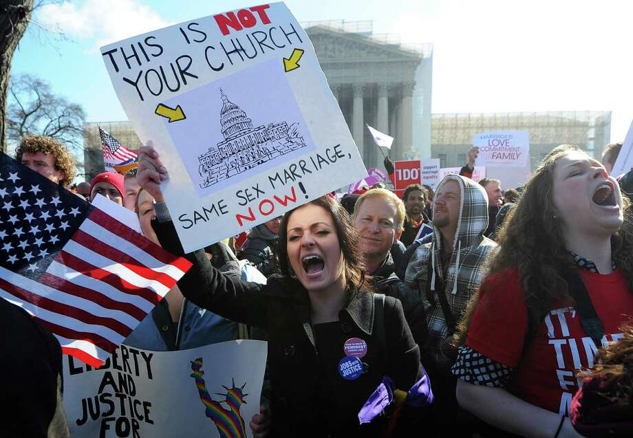 Same-sex marriage supporters shout slogans in front of the US Supreme Court on March 26, 2013 in Washington, DC. Photo: JEWEL SAMAD, Getty Images / 2013 AFP